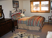 Master bedroom at Ruffed Grouse Lodge - grouse and whitetail deer hunting hunter accommodations