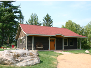 Front view of the Cottage at Elk River Farm, part of Ruffed Grouse Lodge accommodations in Phillips, WI