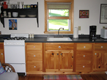 Kitchen pic of Timberdoodle cabin at Ruffed Grouse Lodge in Phillips Wisconsin Price County WI Northwoods Resort